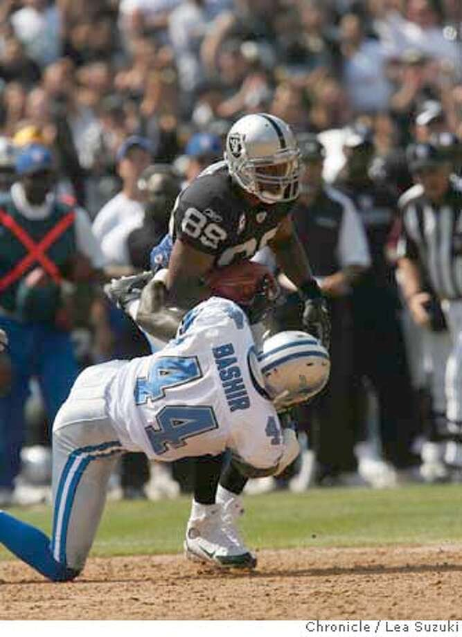 raiders_lions_191_ls.JPG  Ronald Curry gains 17 yards on a pass from McCown to the Det36 then is tackled by Idrees Bashir in the second quarter. Oakland Raiders vs. Detroit Lions at McAfee Coliseum in Oakland. Photo by Lea Suzuki/The Chronicle  Photo taken on 9/9/07, in Oakland, CA. �2007, San Francisco Chronicle  MANDATORY CREDIT FOR PHOTOG AND SAN FRANCISCO CHRONICLE/NO SALES-MAGS OUT Photo: LEA SUZUKI