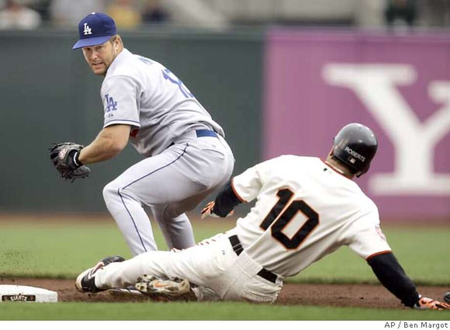 San Francisco Giants' Dave Roberts (10) slides behind Los Angeles Dodgers second baseman Jeff Kent with a double during the first inning of a baseball game Sunday, Sept. 9, 2007, in San Francisco. Roberts scored later in the inning. (AP Photo/Ben Margot) Photo: Ben Margot