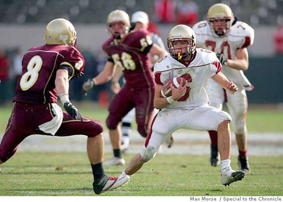 HH0S9901.JPG  Cardinal Newman junior Max Pond runs with the ball against Oaks Christian defender Sean Wiser in the 2006 Division III CIF State Football Championship Bowl Game at the Home Depot Center in Carson, CA December 16, 2006. Cardinal Newman was defeated 27-20 in overtime. By MAX MORSE/SPECIAL TO THE CHRONICLE Photo: MAX MORSE