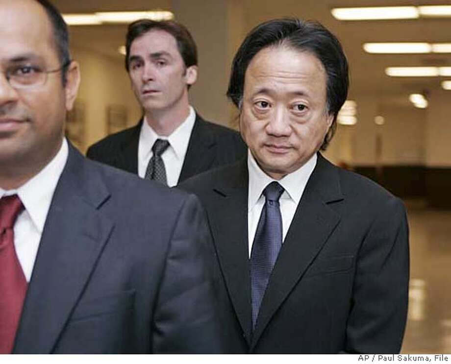 *FILE**Norman Hsu, right, prepares to surrender as he arrives with spokesman Jason Booth, center, and attorney Somnath Raj Chatterjee, left, at a San Mateo County Superior Court in Redwood City, Calif., Friday, Aug. 31, 2007. Hsu, a top Democratic fundraiser wanted as a fugitive in California, turned himself in Friday to face a grand theft charge. After reports surfaced this week of Hsu's fugitive status in California, Sen. Hillary Rodham Clinton, (D-NY) joined other candidates in returning thousands of dollars Hsu raised. Hsu was arrested in a Colorado hospital late Thursday Sept. 6, 2007 after he failed to show up for a court appearance related to a felony theft conviction in California. (AP Photo/Paul Sakuma, file) AUG 31, 2007 FILE PHOTO Photo: Paul Sakuma