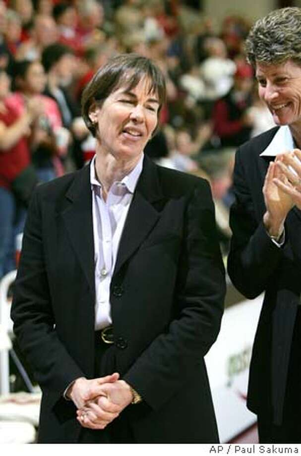 Stanford head coach Tara VanDerveer, left, smiles with associate head coach Amy Tucker, right, during Stanford's 87-54 win over Oregon State in their NCAA basketball game, Saturday, Feb. 4, 2006 in Stanford, Calif. The game was VanDerveer's 650th career college head coaching victory. (AP Photo/Paul Sakuma) Photo: PAUL SAKUMA