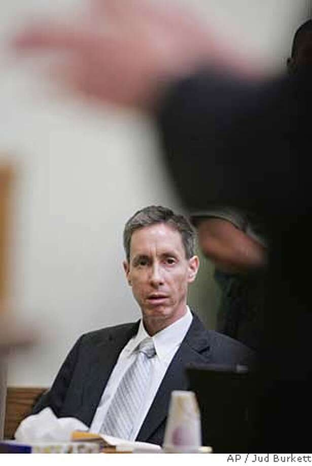 Warren Jeffs, looks on as Washington County Attorney Brock Belnap argues a point during a pre-trial motion hearing in Fifth District Court Friday, Sep. 7, 2007, in St. George, Utah. Warren Jeffs, 51, is charged with first-degree felony rape as an accomplice. A young woman claims she was forced into a spiritual marriage with a 19-year-old cousin in 2001 when she was 14.(AP Photo/Jud Burkett, Pool) POOL PHOTO Photo: JUD BURKETT