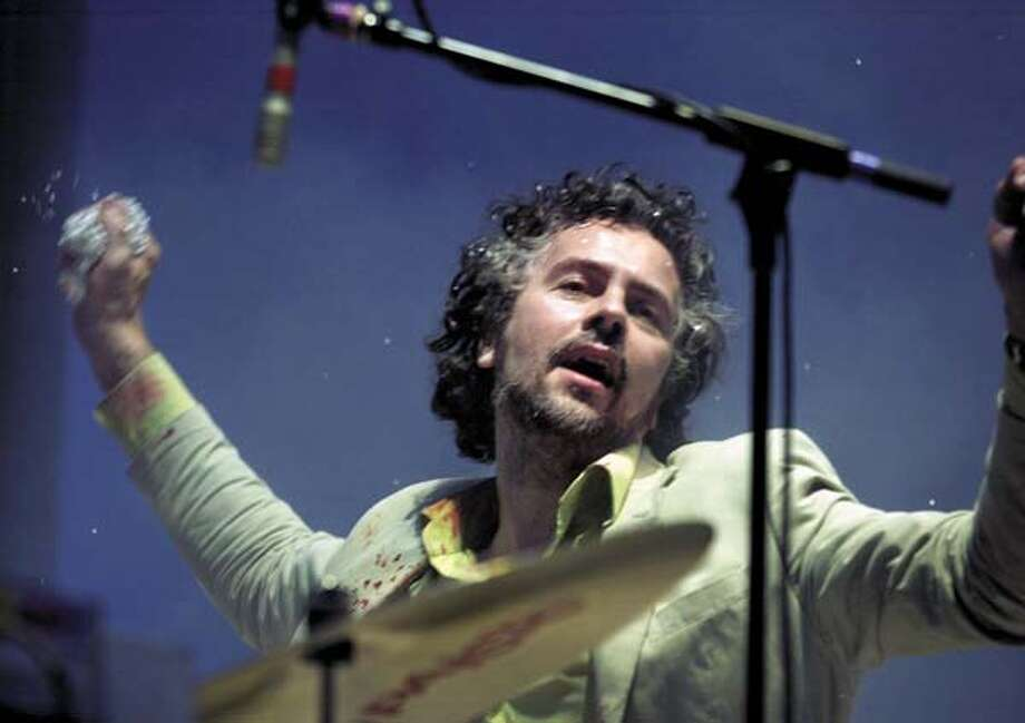 Wayne Coyne appears with Flaming Lips on  - March 27 at Bimbo's 365 Club. Chronicle file photo, 2002, by Darryl Bush