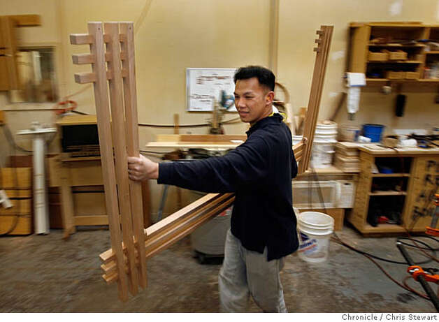 "Event on 2/3/06 in Berkeley.  Craftsman Huong Tran carries a sub-assembly for a Mesa love seat at Berkeley Mills, 2830 7th St. in Berkeley, a furniture store and furniture design and building shop that produces work of craft and quality. For the ""The Art of Craft"" series.  Chris Stewart / The Chronicle MANDATORY CREDIT FOR PHOTOG AND SF CHRONICLE/ -MAGS OUT Photo: Chris Stewart"