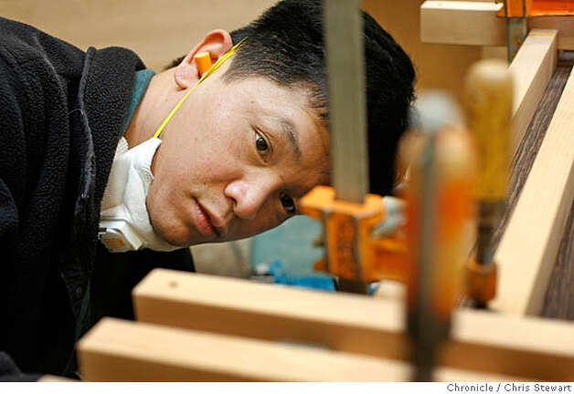 "Event on 2/3/06 in Berkeley.  Craftsman Tai Nham works on a Mesa side chair at Berkeley Mills, 2830 7th St. in Berkeley, a furniture store and furniture design and building shop that produces work of craft and quality. For the ""The Art of Craft"" series.  Chris Stewart / The Chronicle MANDATORY CREDIT FOR PHOTOG AND SF CHRONICLE/ -MAGS OUT Photo: Chris Stewart"