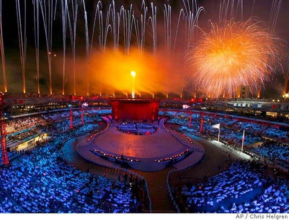 Fireworks Erupt Over The Stadium After Olympic Flame Was Lit During Opening Ceremony For