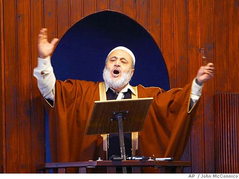 """Imam Ahmed Abu Laban speaks at Friday prayers Friday Feb. 10, 2006 at his mosque in Copenhagen, Denmark. Abu Laban denied stirring violence in the Muslim world over the Prophet Muhammad drawings and called on the West to respect Islamic values. """"We have not put fuel on the fire,"""" Abu Laban told reporters. """"We have not stirred or agitated the Muslim masses."""" Abu Laban and other Danish clerics have been accused of stoking outrage over the cartoons by spreading anti-Danish propaganda to Arabic media and during trips to the Middle East. (AP Photo/John McConnico) Photo: JOHN MCCONNICO"""