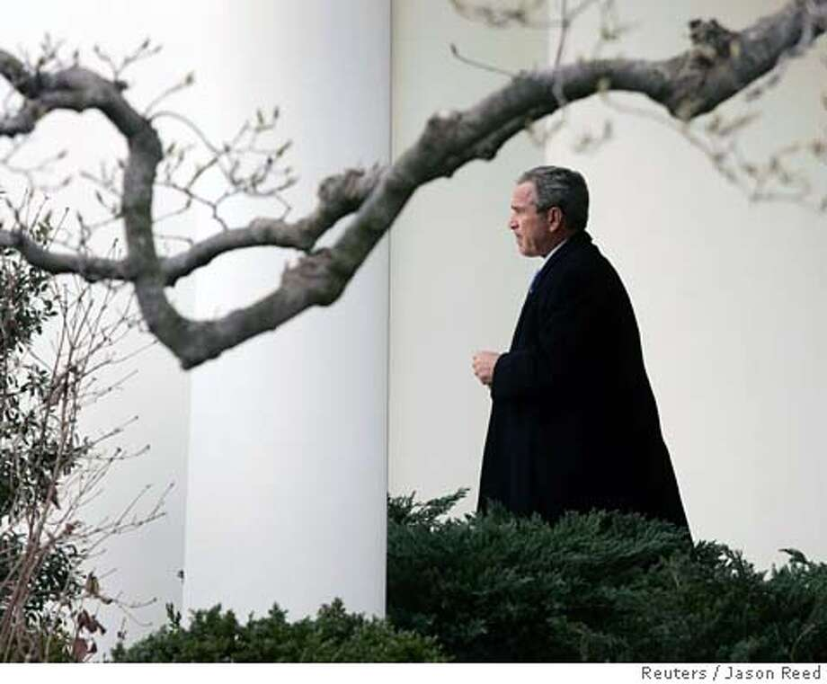 U.S. President George W. Bush walks to Marine One from the Oval Office of the White House in Washington, February 10, 2006. Bush headed to Cambridge, Maryland, to make remarks at the House Republican Conference. REUTERS/Jason Reed 0 Photo: JASON REED