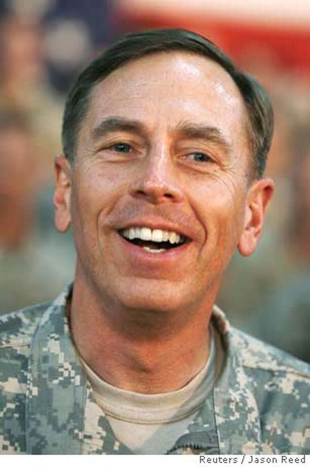 The U.S. military commander in Iraq, General David Petraeus, is pictured during a visit by U.S. President George W. Bush to the Al-Asad Air Base in Anbar Province, Iraq, September 3, 2007. Petraeus, and U.S. Ambassador to Iraq Ryan Crocker are expected to deliver a long-awaited assessment to the Democrat-controlled Congress on Monday, on President George W. Bush's decision to send 30,000 extra soldiers to Iraq. Picture taken September 3, 2007. REUTERS/Jason Reed (IRAQ) 0 Photo: JASON REED