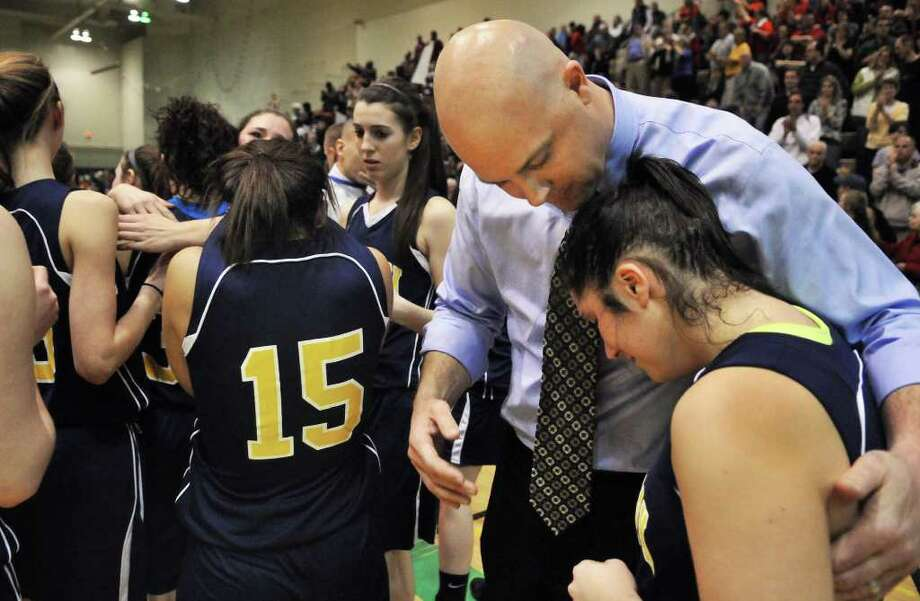 Averill Park coach Sean Organ consoles Julia Mai after their loss to East High for the state Class A girls' basketball championship at HVCC in Troy Saturday March 17, 2012.   (John Carl D'Annibale / Times Union) Photo: John Carl D'Annibale / 00016825A