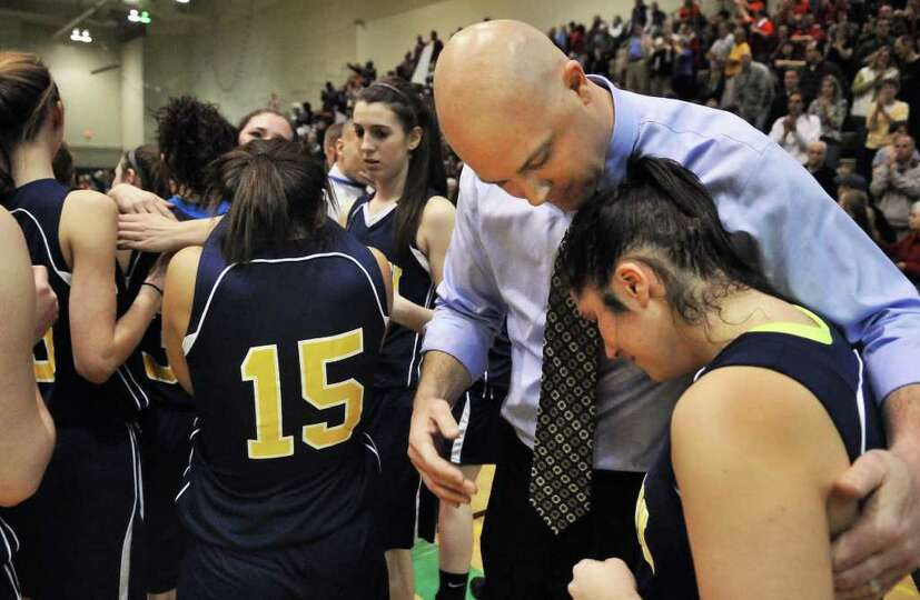 Averill Park coach Sean Organ consoles Julia Mai after their loss to East High for the state Class A