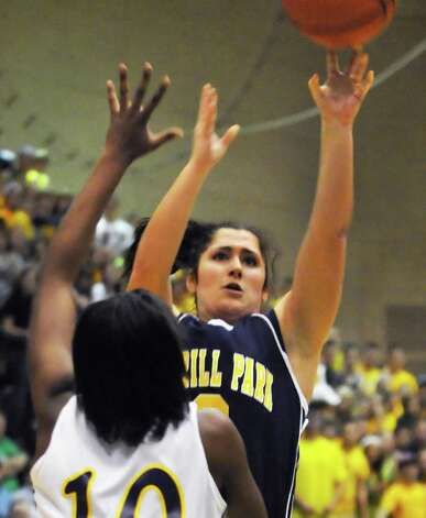 Averill Park's #3 Julia Mai gets a shot past East High's #10 Taylor Hosbey, at left, during the state Class A girls' basketball final int the McDonough Complex at HVCC un Troy Saturday March 17, 2012.   (John Carl D'Annibale / Times Union) Photo: John Carl D'Annibale / 00016825A