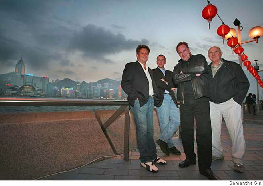 The San Francisco Symphony Orchestra players, (from L to R?John Engelkes, Jeff Anderson?Mark Lawerence and Chris Bogios, are being joy during the sightseeing around the harbour front against the colourful skyline in Hong Kong on 08 February 2006. Photo by Samantha Sin Photo: Samantha Sin