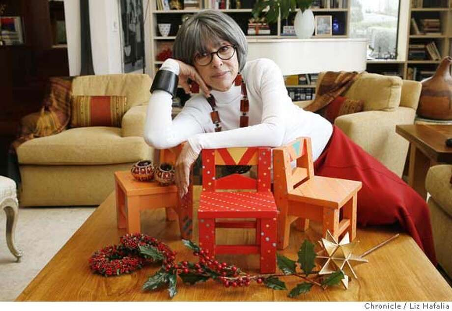 SFIS_RITA16_008.JPG Rita Moreno has three colorful Mexican chairs that she's had for 15-20 years and only uses them at Christmas. Photographed by Liz Hafalia SFIS1606  Ran on: 11-16-2006 Ran on: 11-16-2006  Entertainer Rita Moreno looks forward to the holiday season, when three small hand-painted chairs are a traditional part of the Christmas decor in her Oakland hills home. MANDATORY CREDIT FOR PHOTOGRAPHER AND SAN FRANCISCO CHRONICLE/NO SALES-MAGS OUT Photo: Liz Hafalia