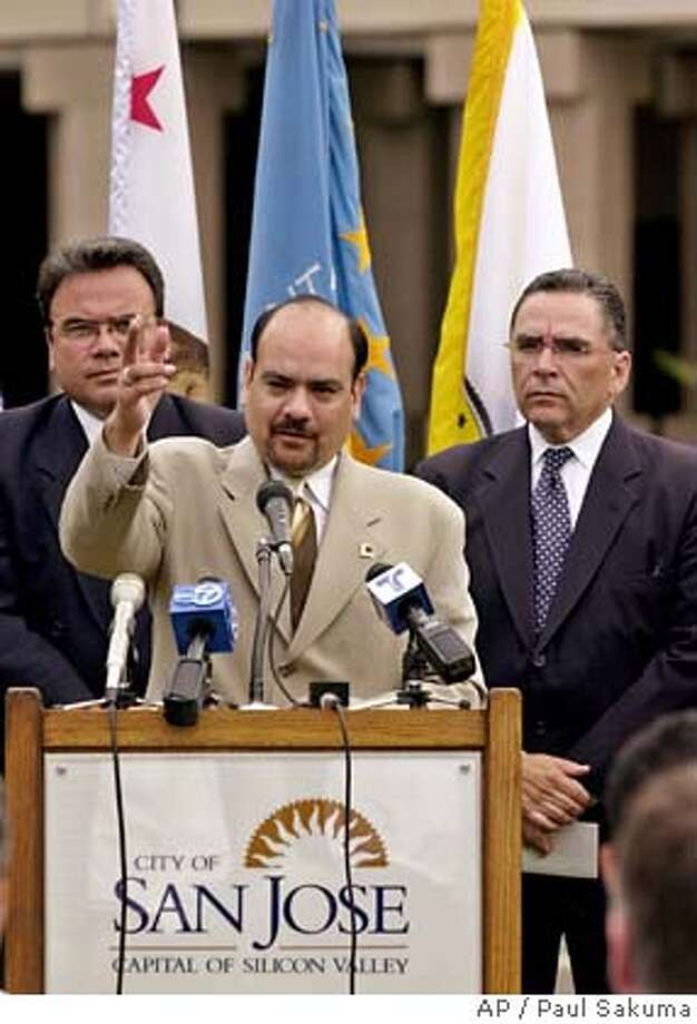 Arturo Vargas, executive director of the National Association of Latino Elected Officials, gestures during a news conference as San Jose Mayor Ron Gonzalez, right, and State Assemblyman Manny Diaz, D-San Jose, left, listen in San Jose, Calif., Monday, June 25, 2001 to announce the NALEO convention. (AP Photo/Paul Sakuma) DIGITAL IMAGE HOLD OF FUTURE USE MAY MOVE FRIDAY