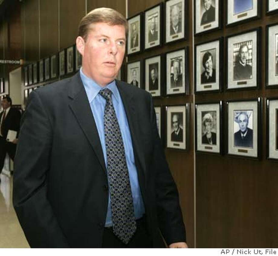 Anaheim, Calif., Mayor Curt Pringle arrives at the Santa Ana Superior courthouse, Friday, Jan. 13, 2006, in Santa Ana, Calif., as opening statements are expected in the civil trial that pits the Angels against their home city of Anaheim. The city of Anaheim is suing the Angels after the baseball team's owner, Arte Moreno, abruptly changed the name from the Anaheim Angels to the Los Angeles Angels of Anaheim in January, 2005. (AP Photo/Nick Ut) Ran on: 02-03-2006  Mayor Curt PringleRan on: 02-03-2006  Owner Arte Moreno Photo: NICK UT