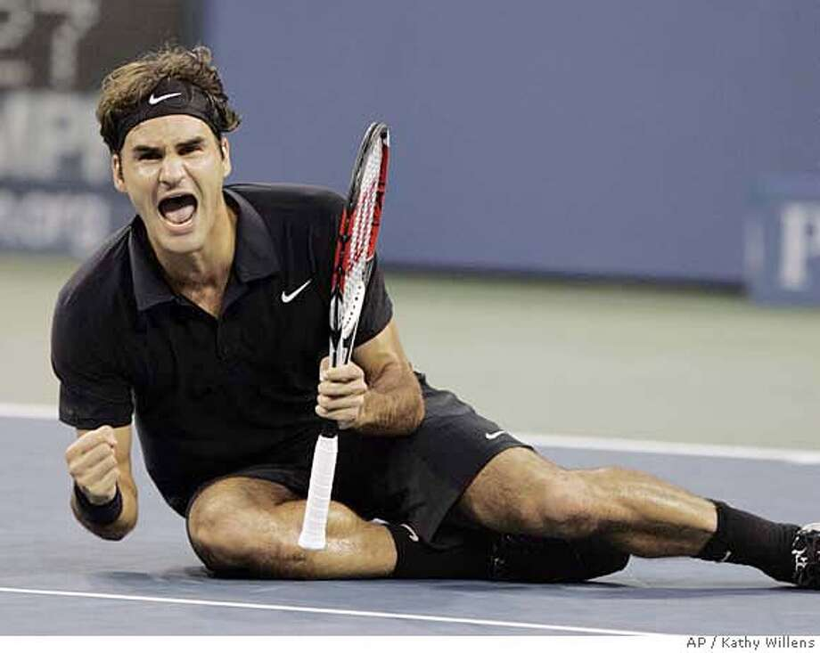 Roger Federer of Switzerland celebrates after winning the men's finals against Novak Djokovic of Serbia at the US Open tennis tournament in New York, Sunday, Sept. 9, 2007. (AP Photo/Kathy Willens) Photo: Kathy Willens