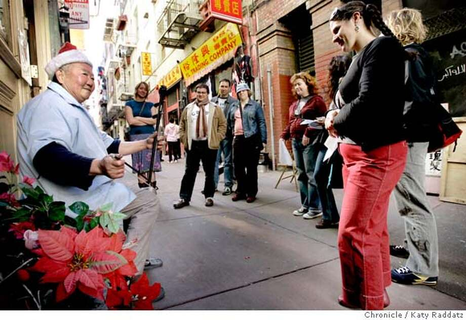 MUNDANE09_68_RAD.JPG SHOWN: In the Chinatown part of the tour, famous hair stylist Jun Yi sits outside his shop on Ross Alley and plays music on the ehru for one and all. Story about Mundane Journeys Bus Tour, an occasional bus tour that highlights non-touristed neighborhoods and encourages exploration of San Francisco. It's part of the art project Mundane Journeys, by an artist named Kate Procrass. Reyhan Harmanci writes for Datebook. Photo taken on 2/5/06, in San Francisco, CA.  By Katy Raddatz / The San Francisco Chronicle MANDATORY CREDIT FOR PHOTOG AND SF CHRONICLE/ -MAGS OUT Photo: Katy Raddatz