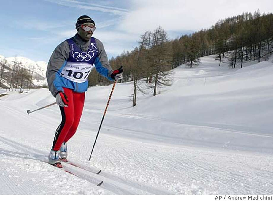 Phillip Boit from Kenya trains for the Cross Country competitions at the Turin 2006 Winter Olympic Games in Pragelato near Sestriere, Italy, Tuesday, Feb 7, 2006. The Winter Olympics are to be opened Friday, Feb 10. (AP Photo/ Andrew Medichini) Photo: ANDREW MEDICHINI