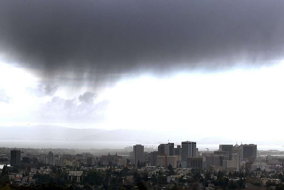 Storm clouds pass over downtown Oakland Saturday, March 17, 2012. The recent onslaught of storms has pushed the Bay Area up to about 50 percent of normal rainfall, and more wet weather is on the way. Photo: Lance Iversen, The Chronicle