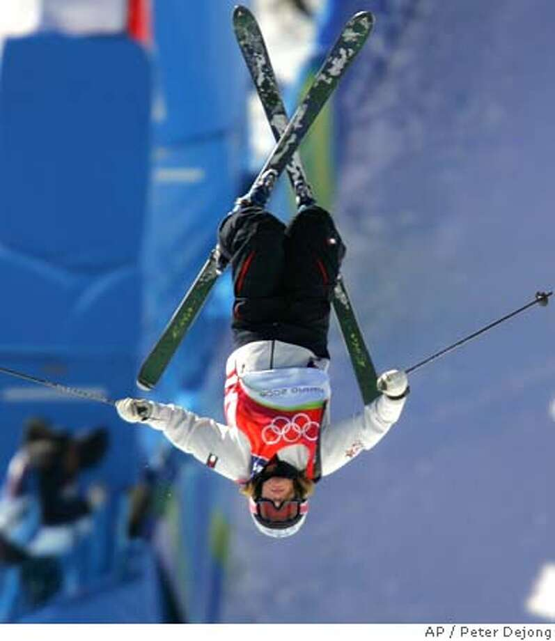 American Shannon Bahrke jumps off the ramp during the training session Women's Moguls at Sauze d'Oulx, Italy, Thursday Feb. 9, 2006. The Turin 2006 Winter Olympic Games start on Friday Feb. 10. (AP Photo/Peter Dejong)