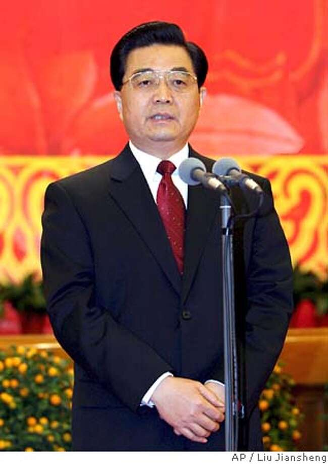 Chinese President Hu Jintao speaks during a grand gathering celebrating the upcoming Spring Festival at the Great Hall of the People in Beijing on Friday, Jan. 27, 2006. Around 4,000 people from various circles were present at the gathering, held by the Central Committee of the Chinese Communist Party and the State Council, or China's central government, according to China's Xinhua news agency. The Spring Festival, or Chinese lunar New Year, starts from Jan. 29. (AP Photo/Xinhua Photo, Liu Jiansheng) Photo: LIU JIANSHENG
