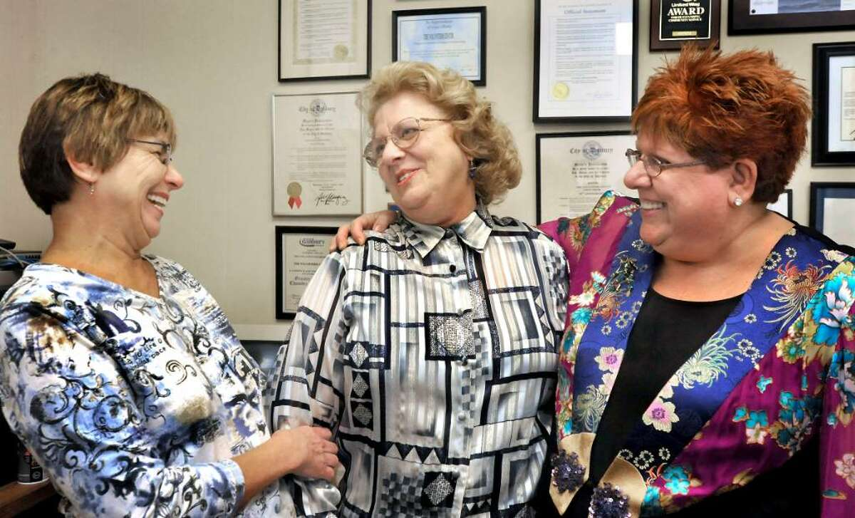 Priscilla Behling, left, and Patti Cohen-Hecht, right, congratulate Eleanore Gianfortune, for being chosen Volunteer of the Year, at the Volunteer Center, in Danbury, on Thursday, Nov.5,2009.