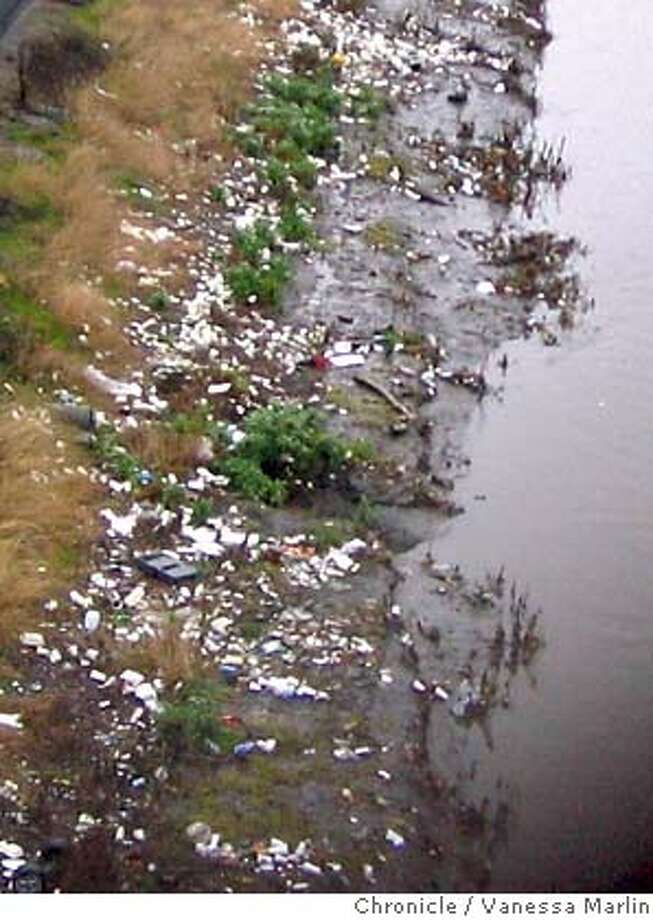 This is trash in the canal by the McAfee Coliseum in Oakland. Photo by Vanessa Marlin/The Chronicle  ALSO Ran on: 12-15-2006 ALSO Ran on: 12-26-2006 Photo: M