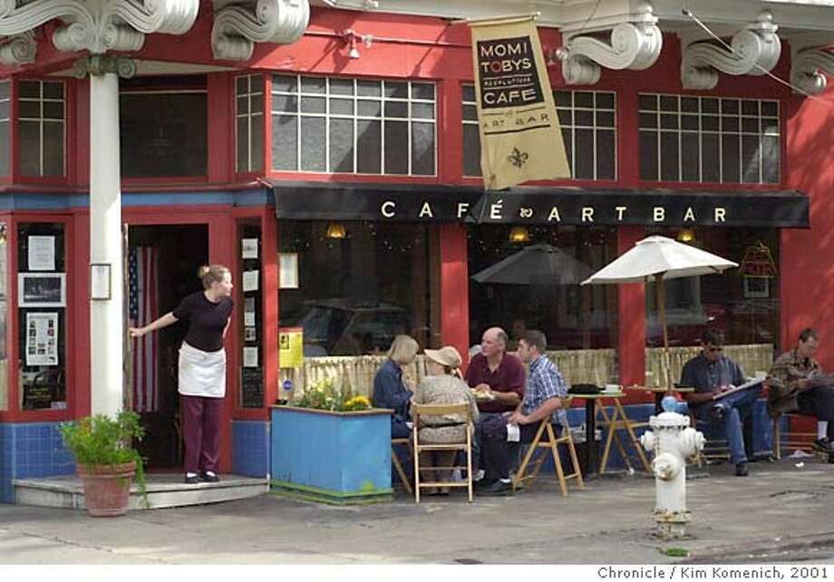 WBLUNCH19a-C-11OCT01-SF-KK Momi Toby's Restaurant and Art Bar at 528 Laguna St. in San Francisco. Kelli Grotzke leaned out the front door to make sure her customers were happy. CHRONICLE PHOTO BY KIM KOMENICH Photo: Kim Komenich