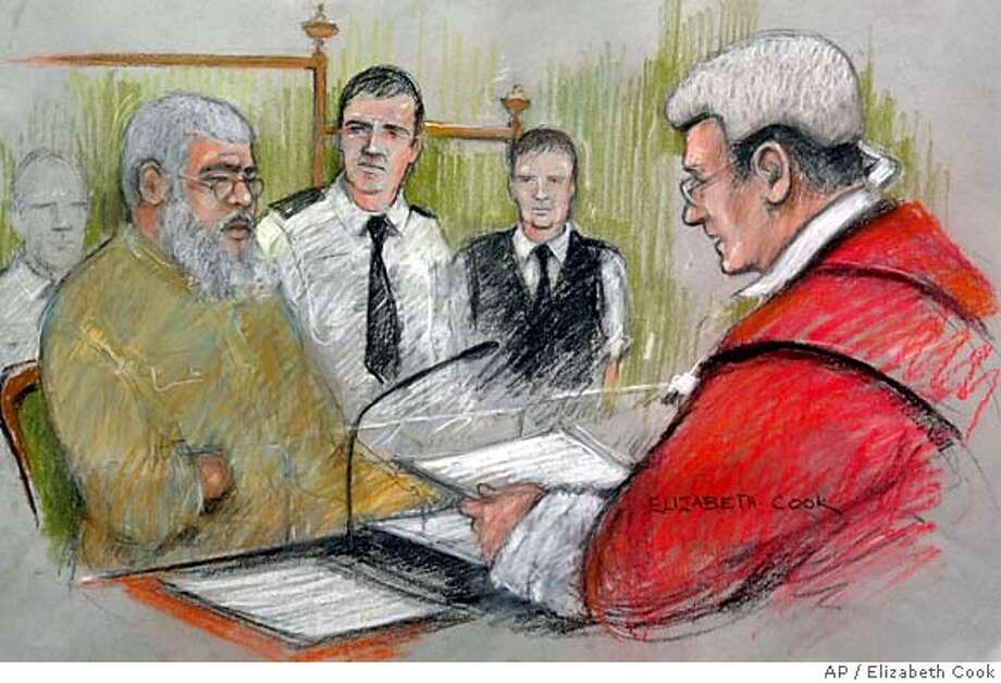 """This is an artist impression of radical Muslim cleric Abu Hamza, left, being addressed by Judge Anthony Hughes,right, in the dock at the Old Bailey, London, Tuesday, Feb. 7, 2006. A jury on Tuesday convicted radial preacher Abu Hamza al-Masri of inciting followers to kill non-Muslims, after a dramatic trial in which prosecutors called the cleric a """"recruiting officer for terrorism and murder"""" who hijacked a great religion for his violent ends. The jury at London's Central Criminal Court found the one-eyed, hook-handed cleric guilty on 11 of 15 charges against him, including counts of soliciting murder, stirring racial hatred, possessing a terrorist document and possessing threatening or abusive recordings. (AP Photo/Elizabeth Cook/PA) ** UNITED KINGDOM OUT NO ARCHIVE TV OUT ** UNITED KINGDOM OUT NO ARCHIVE TV OUT- PHOTOGRAPH CAN NOT BE STORED OR USED FOR MORE THAN 14 DAYS AFTER THE DAY OF TRANSMISSION Photo: ELIZABETH COOK"""