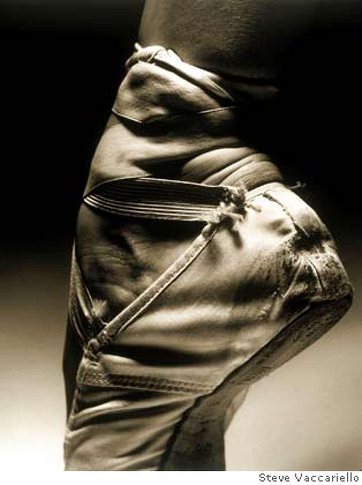 "Caption: Steve Vaccariello / ReleaseCode: ""b5143,�Vaccariello Creative Services, Inc.,talent,slippers,slipper,foot,performer,Pointe,position,practice,routine,shoe,silk,feet,entertainment,discipline,dedication,dancer,culture,ballerina,ballet,arts,people,person,b/w"" / Color: vertical"