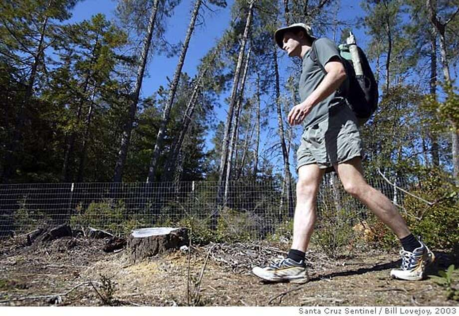 Hiker Scott Williamson walks near his Bonny Doon home in March 2003. He will be talking about his adventures at REI stores this week. Photo by Bill Lovejoy/Santa Cruz Sentinel Photo: Bill Lovejoy