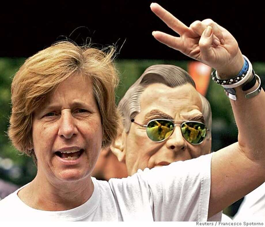 U.S. anti-war activist Cindy Sheehan yells during a protest against Iraq war at the venue of the annual World Social Forum in Caracas January 26, 2006. Tens of thousands of international activists gathered for the World Social Forum to protest against U.S. imperialism and debate topics from fair trade to indigenous rights. The sixth world forum, an event that began in Port Alegre in Brazil, has registered more than 67,000 participants and starts with a march against imperialism and war that will likely focus on U.S. President George W. Bush and the conflict in Iraq. REUTERS/Francesco Spotorno 0 Photo: STRINGER/VENEZUELA