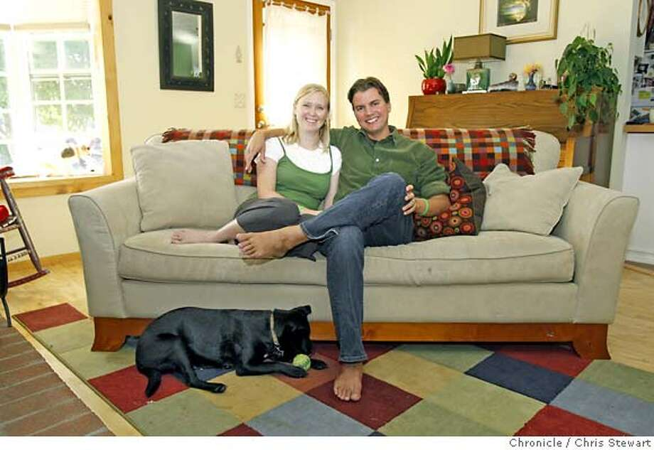 onthecouch_0015_cs.jpg Event on 8/17/07 in Petaluma  Mark and Jenna Hales (both cq) on the couch at their Petaluma home. Joining them are Ruby the dog and Nessie the cat. For the Chronicle magazine On the Couch column. Photographed August 17, 2007. Chris Stewart / The Chronicle On the Couch, Mark Hales, Jenna Hales Ran on: 09-09-2007 Photo: Chris Stewart