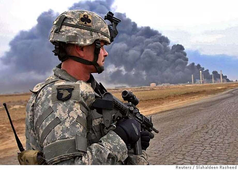 A U.S. soldier stands guard near a damaged oil pipeline complex in Khabaza village near Kirkuk, about 250 km (150 miles) north of Baghdad February 2, 2006. The oil complex was damaged after mortar attacks by insurgents, residents said. REUTERS/Slahaldeen Rasheed 0 Photo: SLAHALDEEN RASHEED