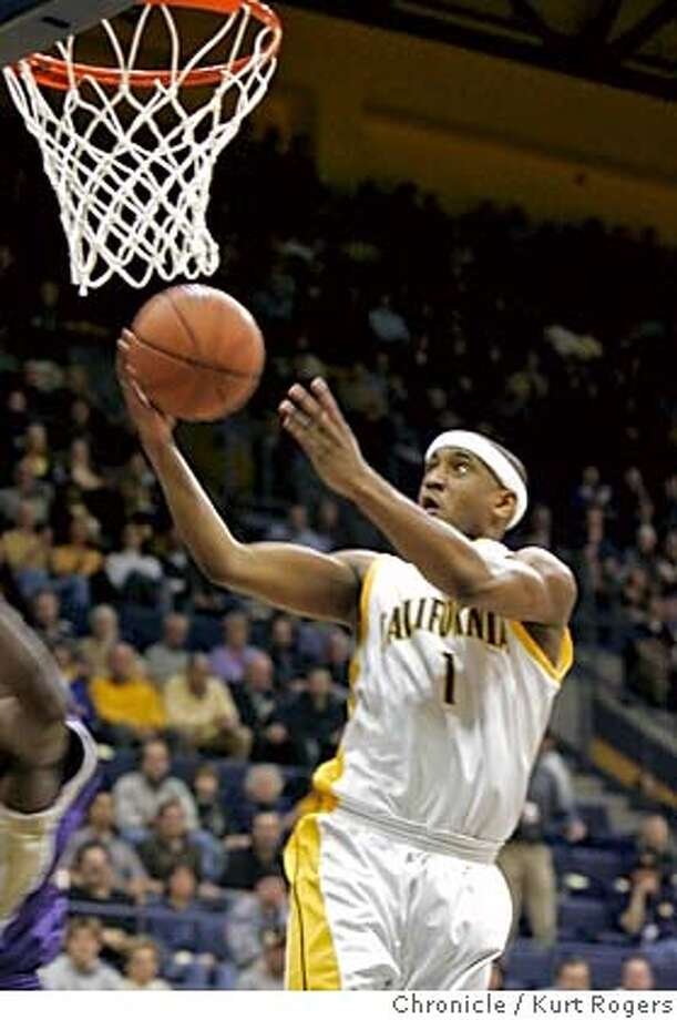 Cals Ayinde Ubaka up for a layout in the first period after the steal.  The Washington Huskies vs the California Golden Bears.  Kurt Rogers BERKELEY SFC  The Chronicle CAL27_00157_kr.JPG Ran on: 01-27-2006  Cal guard Ayinde Ubaka had 15 points and seven assists in the win over No. 10 Washington. Ran on: 01-27-2006  Cal guard Ayinde Ubaka had 15 points and seven assists in the win over No. 10 Washington. MANDATORY CREDIT FOR PHOTOG AND SF CHRONICLE/ -MAGS OUT Photo: Kurt Rogers