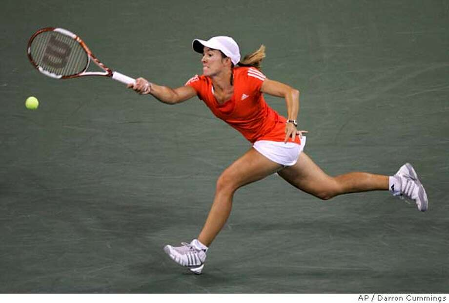 Justine Henin of Belgium chases a shot from Svetlana Kuznetsova of Russia during the women's finals at the US Open tennis tournament in New York, Saturday, Sept. 8, 2007. (AP Photo/Darron Cummings) Photo: Darron Cummings