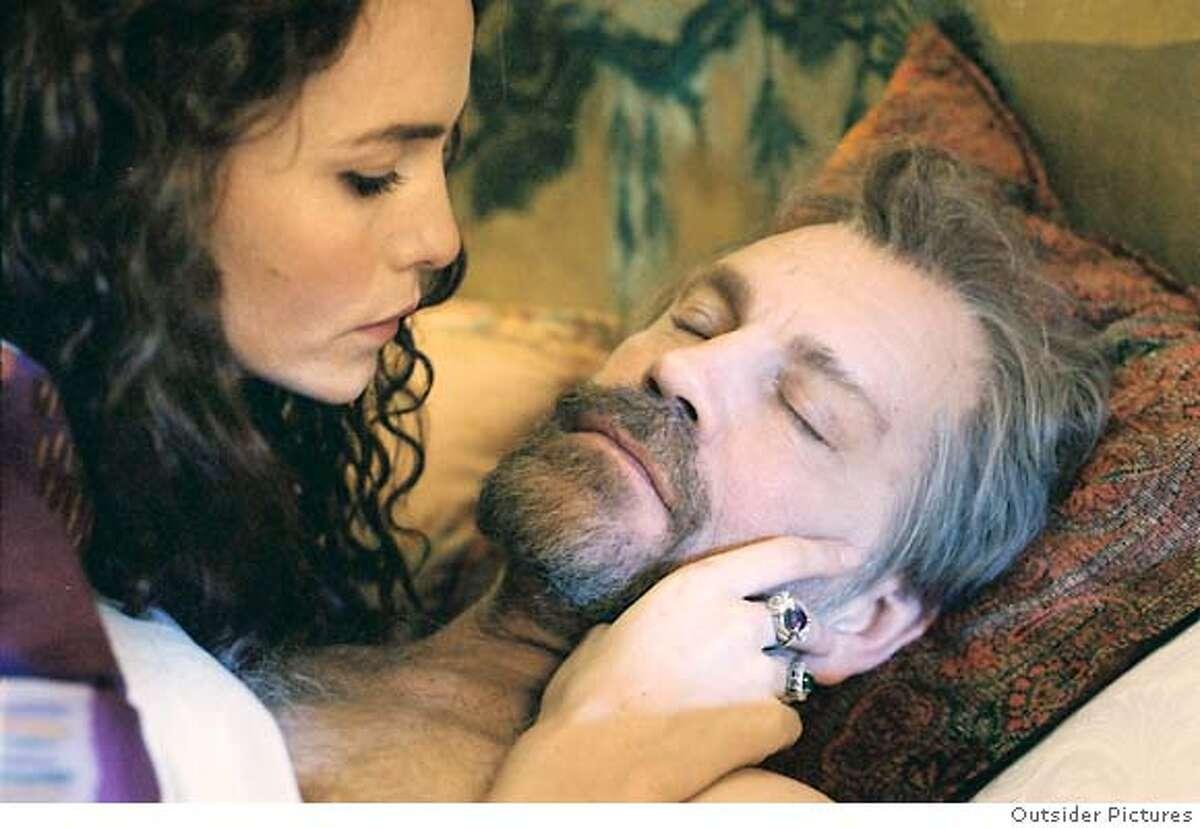 """Saffron Burrows and John Malkovich in """"Klimt"""" a biopic about artist Gustav Klimt."""