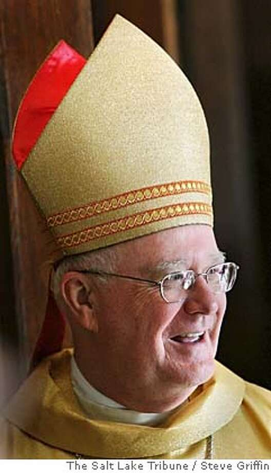 Bishop George H. Niederauer greats his parishioners following the celebration of his farewell mass at the Cathedrel of the Madeleine in Salt Lake City Feb. 5, 2006. Photo by Steve GriffinRan on: 02-08-2006  George Niederauer is seen as personable and learned. Photo: Steve Griffin