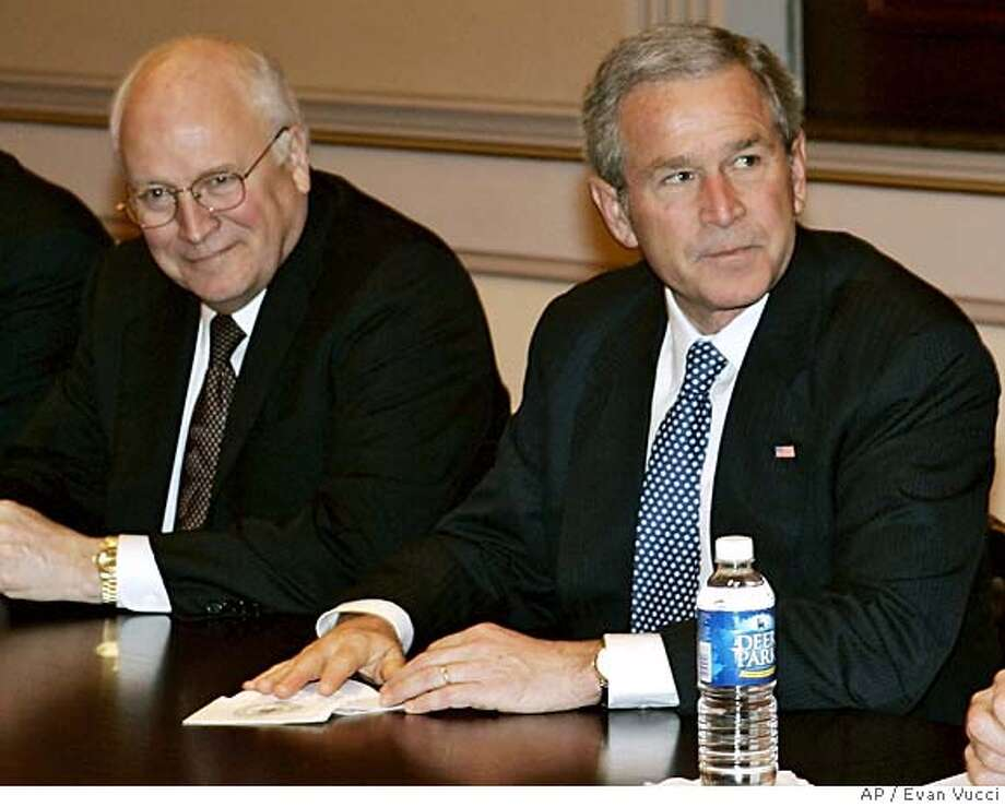 President Bush sits with Vice President Dick Cheney, left, before meeting with the Senate Republican Conference on Friday, Jan. 27, 2006 in Washington. (AP Photo/Evan Vucci)Ran on: 02-05-2006  Vice President Dick Cheney told CNN in December that the warrantless wiretaps have &quo;saved thousands of lives.&quo; Photo: EVAN VUCCI