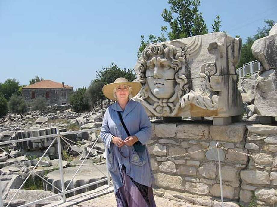 TRAVEL JUSTBACK -- Renee Gibbons, San Francisco Email: banshee712@aol.com  Daytime phone number: 415-391-2563 Just back from: Didim, Turkey I went because: To see the ancient ruins before I become an ancient ruin myself. Don't miss: A visit to a hamam - traditional Turkish bath where your will be washed, pummeled, oiled and massaged for very little money. Don't bother: Packing shorts or skimpy outfits as modesty is appreciated and sometimes required in this country that is 99% Muslim. Coolest souvenir: A small painting of the Whirling Dervishes. Since their ritual is sacred, it is forbidden to photograph it. Worth a splurge: Hotel Kismet at nearby Kusadasi, a peaceful haven away from the 'seaside resort madness' of the Turquoise Coast of Turkey. I wish I'd packed: Some small souvenirs of San Francisco to give to the friends I made along the way. Turks are very very friendly. Other comments: Turkish food is scrumptious. Lots of fresh fruits and vegetables, plus lamb and fish. Details of attached photo (if sent): Renee Gibbons at the ruins in Didyma, Turkey. [Head of Medusa] 6/13/07 in , . ONE-TIME USE - NOT TO BE USED ON WEB Photo: NA