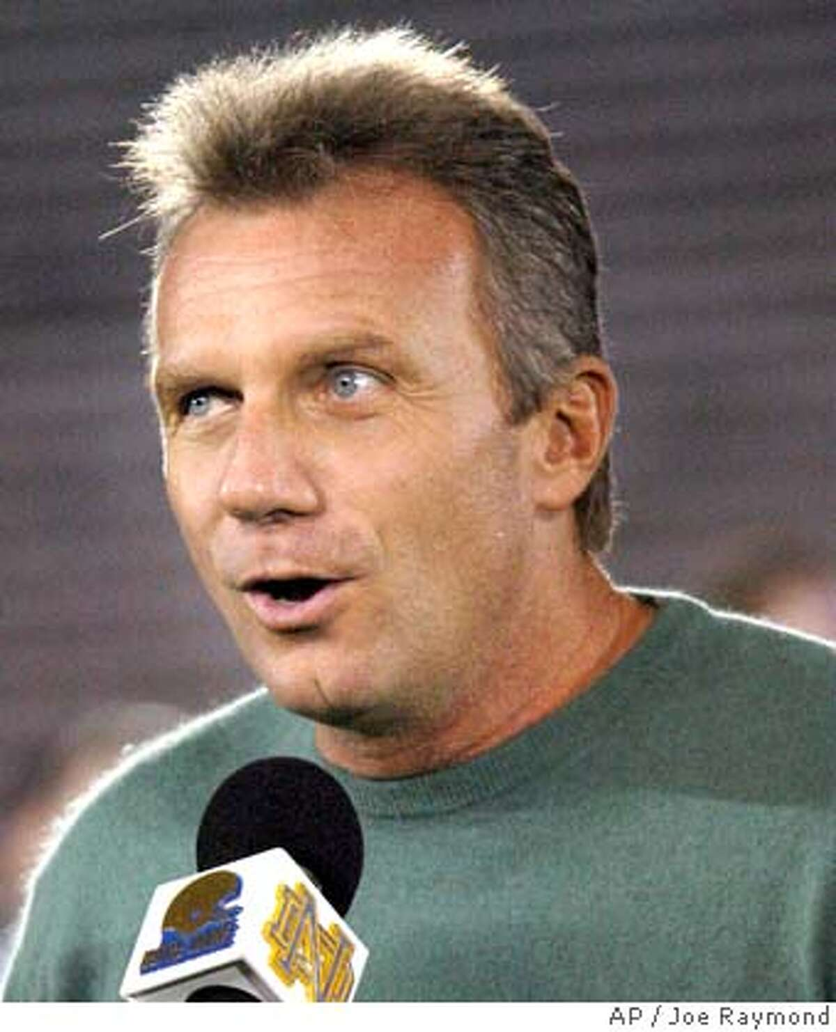 Former Notre Dame quarterback Joe Montana addresses the pep rally at Notre Dame Stadium Friday Oct. 14, 2005, in South Bend, Ind. Notre Dame plays No. 1-ranked Southern California Trojans, Saturday. (AP Photo/Joe Raymond) Ran on: 10-15-2005 Joe Montana was a speaker at the Notre Dame pep rally. Ran on: 10-15-2005 Joe Montana was a speaker at the Notre Dame pep rally.