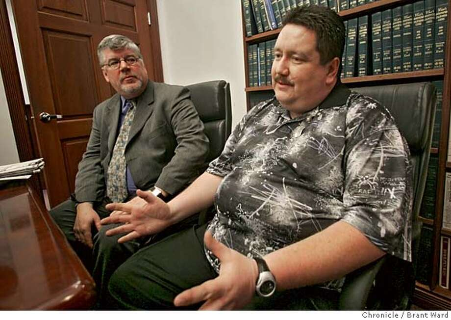 "neeley001_ward.jpg  Lawyer Dan Bacon, left, and his client Jack Neeley talk about the mistake in the newspaper.  Jack Neeley and his lawyer Dan Bacon held a news conference Tuesday to discuss the misidentification of a photograph for the ""Use Of Force"" series in the San Francisco Chronicle. Neeley's picture was used, he was wrongly identified as a SFPD officer who uses to much force in his job.  Brant Ward2/7/06 Photo: Brant Ward"