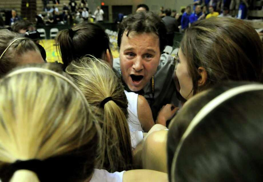 Hoosic Valley's coach Walter Dorman, center, celebrates with his team when they win 37-32 over Coleman Catholic in their Class C girls' basketball state semifinal on Saturday, March 17, 2012, at Hudson Valley Community College in Troy, N.Y. (Cindy Schultz / Times Union) Photo: Cindy Schultz / 00016824A