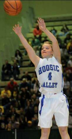Hoosic Valley's Cassidy Chapko (4) hits the the 3-point basket with time ticking off the clock in their Class C girls' basketball state semifinal against Coleman Catholic on Saturday, March 17, 2012, at Hudson Valley Community College in Troy, N.Y. Hoosic Valley wins 37-32. (Cindy Schultz / Times Union) Photo: Cindy Schultz / 00016824A
