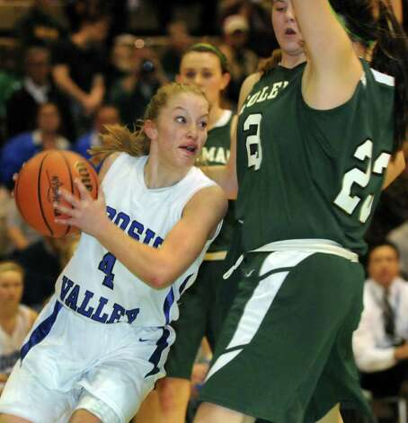 Hoosic Valley's Cassidy Chapko (4), left, works the paint in their Class C girls' basketball state semifinal against Coleman Catholic on Saturday, March 17, 2012, at Hudson Valley Community College in Troy, N.Y. (Cindy Schultz / Times Union) Photo: Cindy Schultz / 00016824A