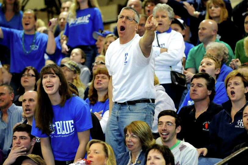 Hoosic Valley fans dispute an official's call during their Class C girls' basketball state semifinal
