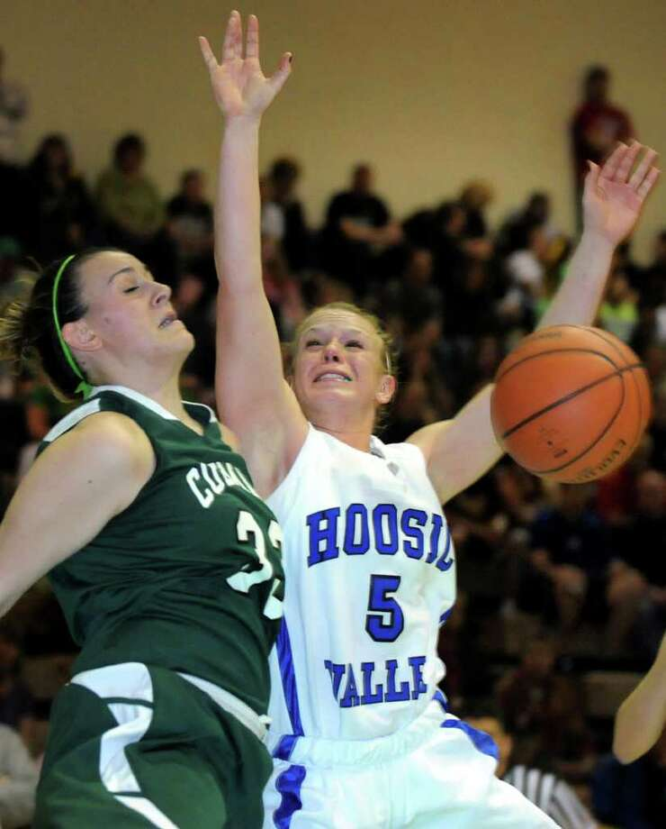 Hoosic Valley's Alicia Lewis (5), right, and Coleman Catholic's Emily Curley (33) fight for a rebound during their Class C girls' basketball state semifinal on Saturday, March 17, 2012, at Hudson Valley Community College in Troy, N.Y. (Cindy Schultz / Times Union) Photo: Cindy Schultz / 00016824A