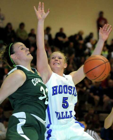Hoosic Valley's Alicia Lewis (5), right, and Coleman Catholic's Emily Curley (33) fight for a reboun
