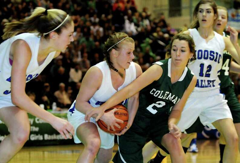 Hoosic Valley's Alicia Lewis (5), center left, and Coleman Catholic's Kate Davis (2) fight for a reb